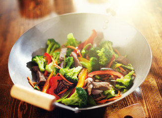 chinese stir fry in wok with beef and vegetables