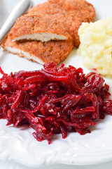 Fresh salad with beetroot, carrots and apples on white backgroun