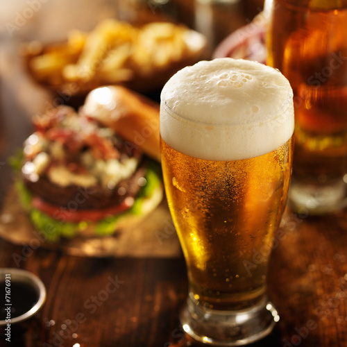 Poster beer with hamburgers on restaurant table