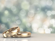 Leinwanddruck Bild - A pair of gold wedding rings with bokeh background