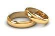 A pair of gold wedding rings - 71677143