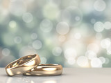 A pair of gold wedding rings with bokeh background - 71677117