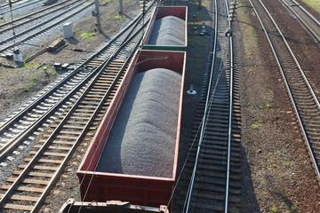 railroad tracks. wagons carrying cargo