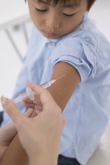 Children receive an injection