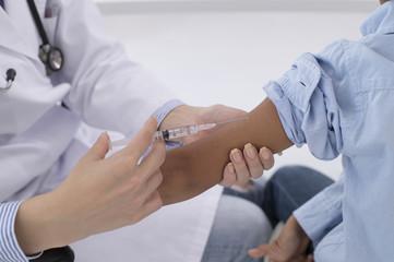 Children receive an injection