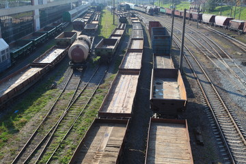 railroad tracks. wagons carrying cargo