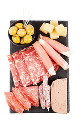 Charcuterie assortment and olives on white background