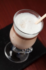 Hot chocolate in glass with chocolate on stick