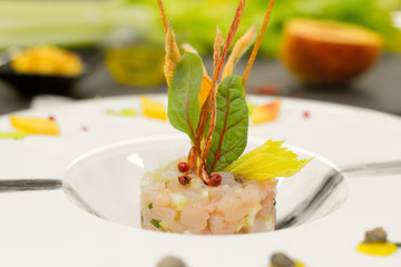 tartar with amberjack, celery and food garnish