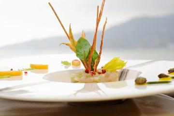 tartare with lampuga fish, celery, and food garnish