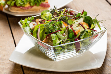 Glass bowl of salad