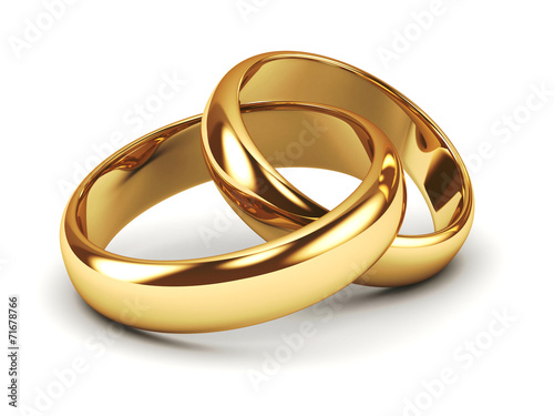 Leinwanddruck Bild A pair of gold wedding rings