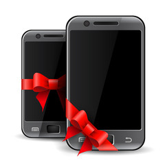 Two mobile phones with red gift ribbon