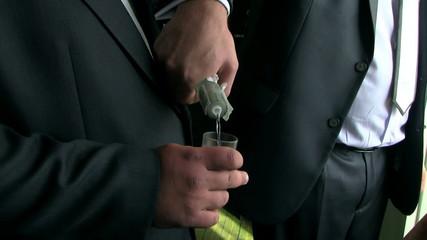 businessman pours vodka