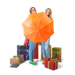 Christmas women with umbrella over white background