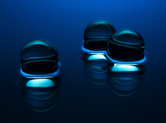 Blue crystal balls in the water - abstract background