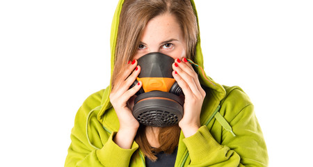 Girl with gas mask over white background