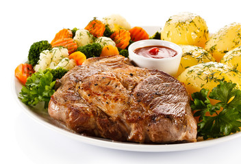 Steak, boiled potatoes and vegetables