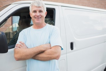 Smiling man in front of delivery van