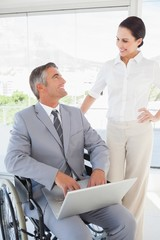 Disabled business man working with partner