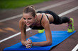 Woman working out on athlete track