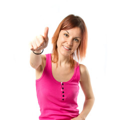 Girl with thumb up over white background