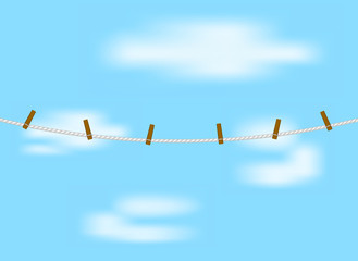 Clothespins on rope in white design and blue sky
