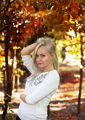 blonde model smiling on the autumn background
