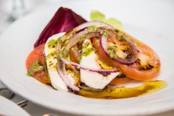Caprese Salad with Onions and Pesto