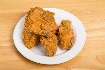 Fried Chicken on Small White Plate and Wood Table