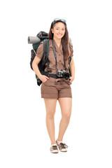 Female traveler with hiking equipment