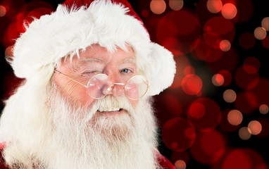 Composite image of santa claus winking