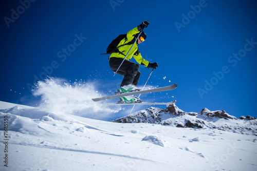 canvas print picture Skier in high mountains