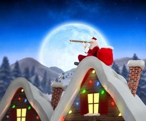 Santa sitting on roof of cottage