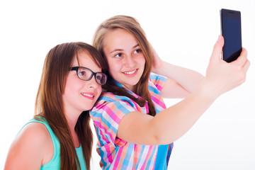 Girlfriends taking selfie with phone