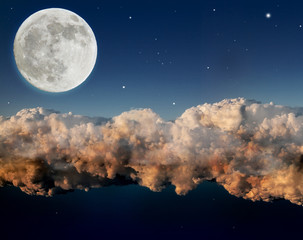 large moon above dark night clouds