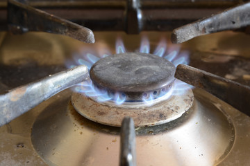 Domestic gas ring with blue flame