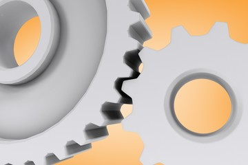 Composite image of white cog and wheel connecting