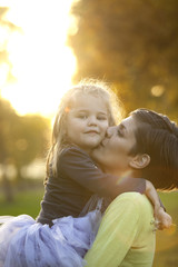 Happy Family Portrait Mother And Daughter Outdoor Kissing