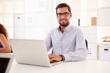 Businessman Using Laptop In Office Of Start Up Business
