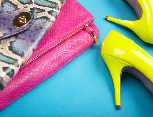 Neon high heels, and snakeskin print bag, woman fashion concept