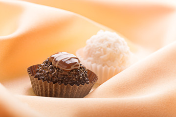 Dark chocolate and white sweets with coconut