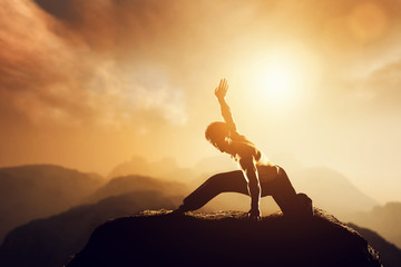 Asian man, fighter practices martial arts in mountains. Sunset
