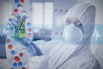 Scientist in protective suit with hazardous chemical