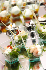 Party buffet with mozzarella and shrimps