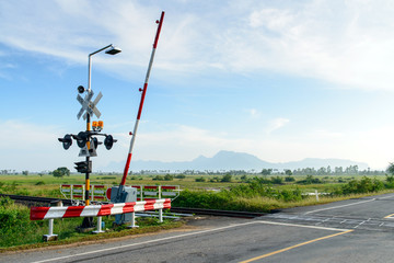 Railway crossing in rural scene
