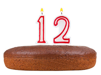 birthday cake with candles number 12 isolated on white