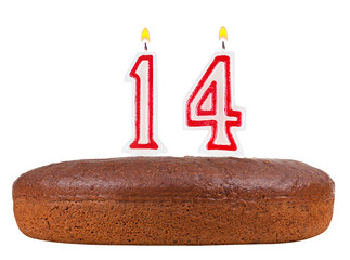 birthday cake with candles number 14 isolated on white