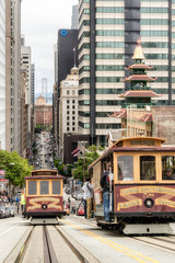 Cable cars traffic in California St., San Francisco