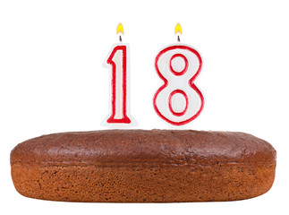 birthday cake with candles number 18 isolated on white